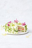 Sandwich cake with salmon, avocado and cream cheese