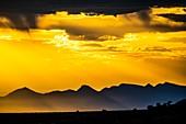 Golden sunset through clouds