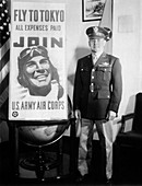 Brigadier General James H. Doolittle with recruiting poster