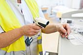 Nurse scanning medicine