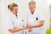 Nurses checking medication