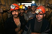 Coal miners in lift