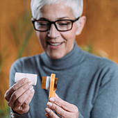 Woman measuring lung capacity and peak expiratory force