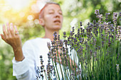 Woman with lavender plant
