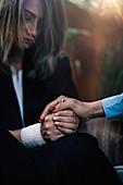 Psychotherapist holding patient's hand