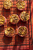 Almond tarts on a cooling rack