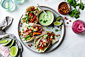 Sweet potato chickpea tacos with cilantro crema on a plate