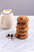 Stack of oats chocolate chip cookies on a white marble table