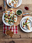 Cheese and fruit skewers with pesto