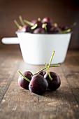 Four Cherries in front of an enamel pan