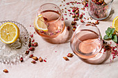 Pink champagne cocktails with dried rose petals