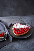 A raspberry heart with sour cream
