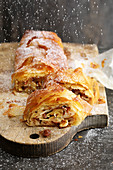 Apple and pear strudel with nuts and raisins