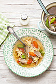 Chicken broth with angel's hair pasta and vegetables