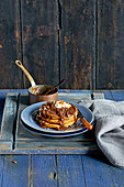Pumpkin pancake stack with walnut and toffee sauce