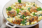 Roasted chicken thighs with gnocci and spinach