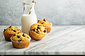Chocolate chip muffins with a bottle of milk