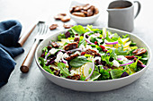Fall salad with pears, mixed greens and caramelized pecan
