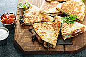 Mushroom, spinach and cheese quesadillas with sour cream and salsa