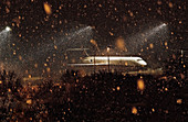 Airplane on tarmac in snow at night
