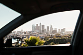 View of sunny cityscape out car window, Los Angeles, California, USA