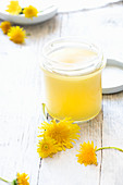 Homemade dandelion ointment for moisturizing and for joint pain