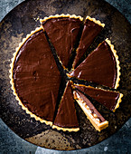 Slices of chocolate tart with caramel