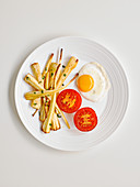 Parsnips fried in honey with fried egg and tomato