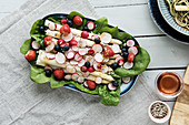 Asparagus salad with radishes, berries and spinach