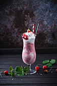 Vegan strawberry ice cream shake with soy cream and fresh berries