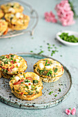 Egg muffins with asparagus, cherry tomatoes halloumi cheese and chives