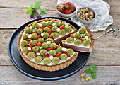 Vegan berry and coconut tart with berry and pistachio cream