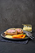 Filet Wellington with Sauce Bernaise and carrots