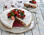 Vegan panna cotta cake with a sponge base and summer berries