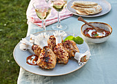Herb chicken drumsticks with apricot dip