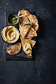 Sourdough flatbreads with whipped cod roe and dill pesto