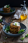 Pancakes with spinach and ricotta served with parmesan and lamb's lettuce