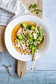 Chicken soup with noodles and green vegetables
