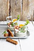 Shrimp and egg salad in glasses