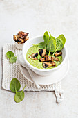Leek and spinach soup with mushroom croutons