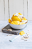 Mango and coconut ice cream with coconut chips
