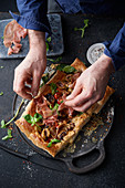 Puff pastry tart with Parma ham, balsamic onions, tomatoes, cheese, mushrooms and olives