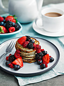 Flaxseed, oat and banana pancakes with crushed berries