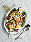 Greek salad with eggs and feta