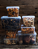 Freshly picked wild mushrooms in storage boxes