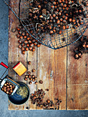 Still life with hazelnuts in a wire basket and nut mill