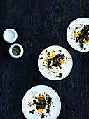 Poached eggs with truffle mayo and kale chips