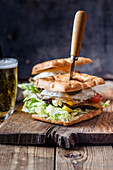 A focaccia burger with beer