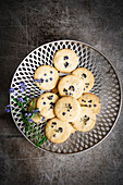 Butter cookies with forget-me-not flowers on a pastry plate