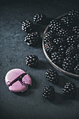 Purple macaroon and blackberries on the plate